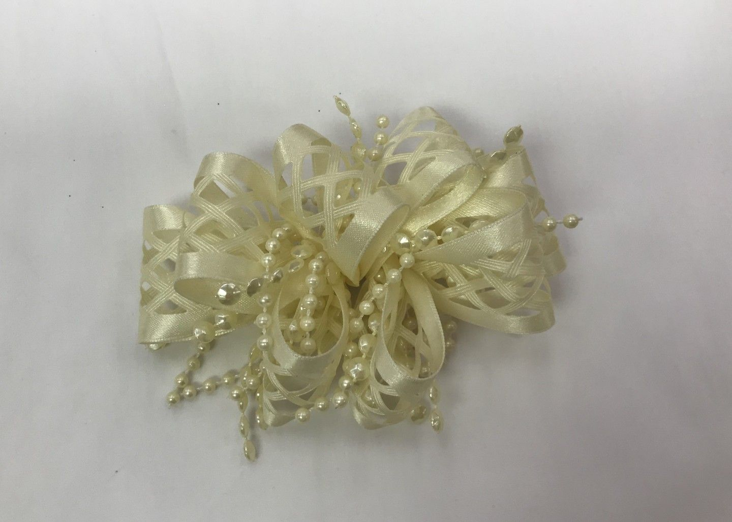 CHEE CHEE IVORY BOW