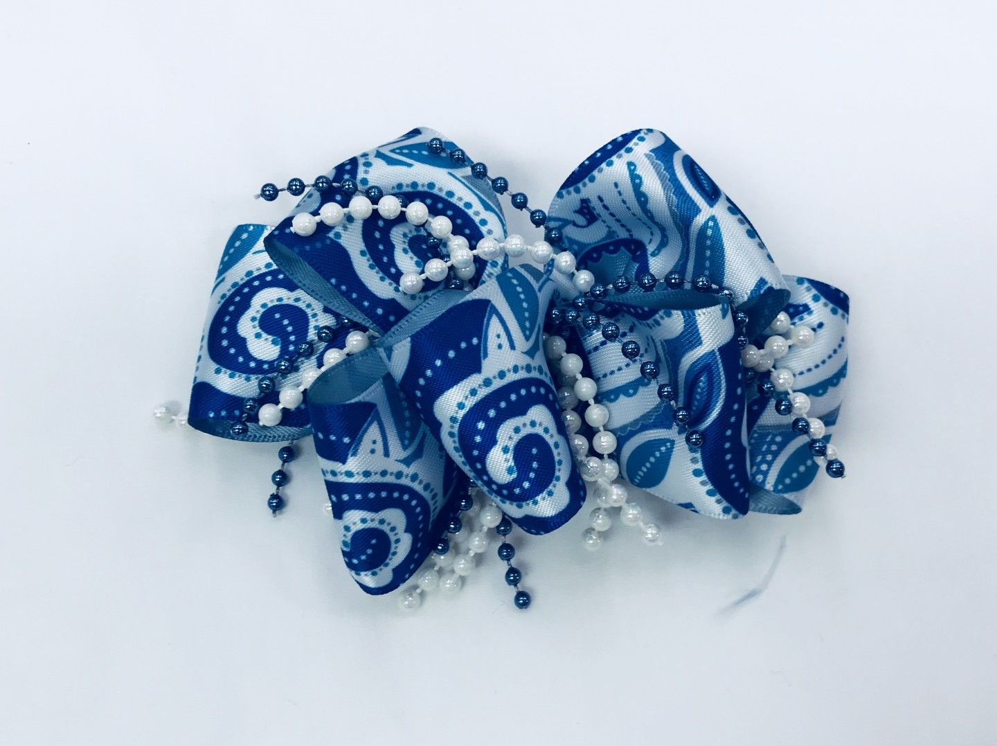 CHEE CHEE BLUE PATTERNED BOW WITH BEADS