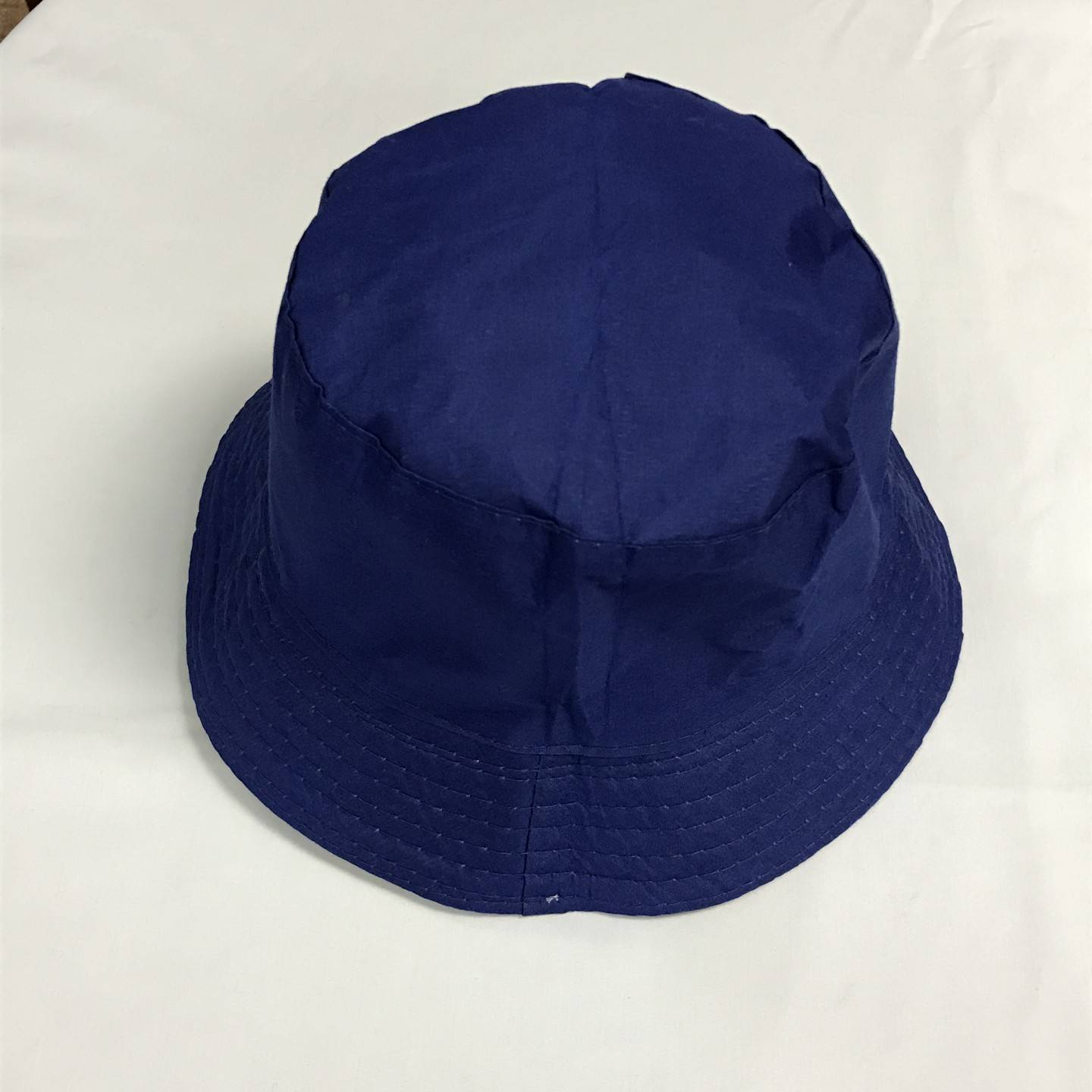 NAVY REVERSIBLE BUCKET HAT 12+